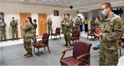 ROBINS AIR FORCE BASE, Ga. – Members of the 78th Medical Group celebrate inside the clinic's atrium at Robins Air Force Base, Georgia, March 1, 2021.