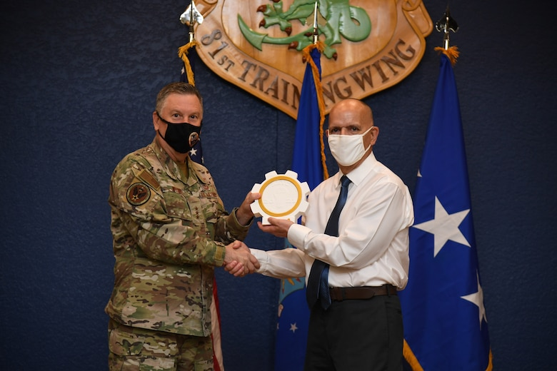 U.S. Air Force Lt. Gen. Marshall B. Webb, commander of Air Education Training Command, presents the iChallenge first place Torch Award to Matthew Correia, Profession of Arms Center of Excellence instructional systems specialist, during the iExpo award ceremony inside the Bay Breeze Event Center at Keesler Air Force Base, Mississippi, May 6, 2021. The iChallenge was created to help inspire personnel around AETC to create new and innovative ways of completing the Air Force mission. Air Force Chief of Staff Gen. Charles Q. Brown, Jr., put in place the Accelerate Change or Lose strategic approach in August 2020 to recognize the rapidly changing technology in the world and to encourage positive change in the Air and Space Forces. This action order has helped shape ideas presented during this year's iChallenge. (U.S. Air Force photo by Kemberly Groue)
