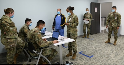 Robins Air Force Base, Ga.- Members of the 78th Medical Group at Robins Air Force Base, Georgia process first responders who are receiving their first COVID-19 vaccinations Jan. 7, 2021.