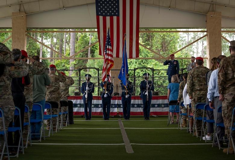 Members of the Hurlburt Field Honor Guard present the colors during a dedication ceremony at Hurlburt Field, Florida, May 6, 2021.