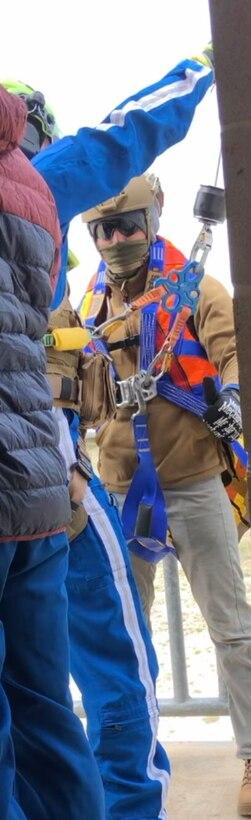 Man in harness on platform
