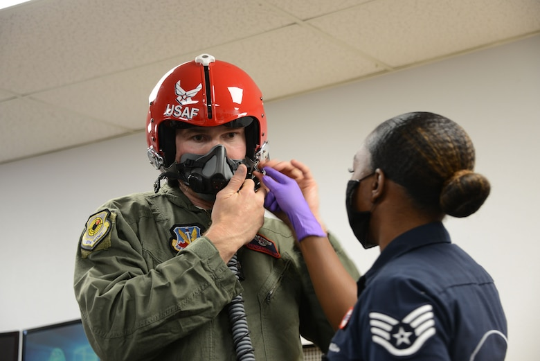 Former Ultimate Fighter Championship champion and UFC Hall of Famer Forrest Griffin getting fitted with a helmet prior to flying with the U.S. Thunderbirds at Nellis Air Force Base, Nevada, Apr. 23, 2021.