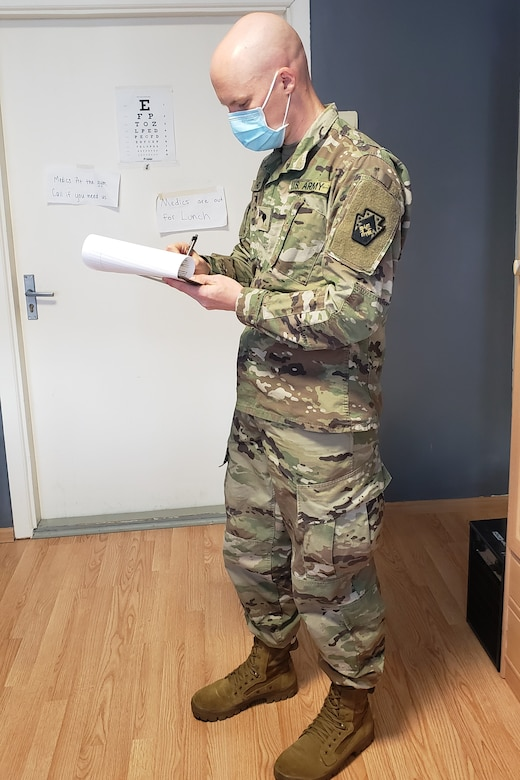 Spc. Bradley Hoyt, a medic with the Pennsylvania National Guard's 108th Medical Company Area Support, works in his office on a Lithuanian Army base in Marijampole, Lithuania, where he is providing medical support to U.S and Lithuanian troops. The 108th MCAS deployed to Europe in late February to provide medical support to U.S. and allied rotational forces in the region.