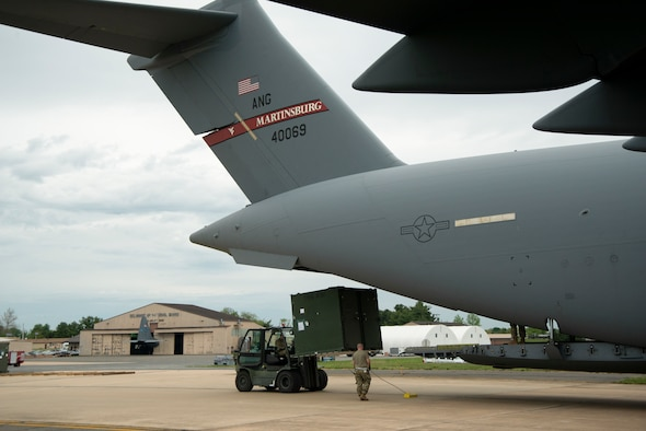 The 167th and 166th Airlift Wings partnered together to conduct a joint cargo loading exercise as part of the 166th's home station operational readiness exercise on May 3 at New Castle Air National Guard Base, Delaware.
