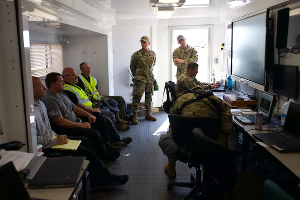 Members of the 63rd Civil Support Team, Oklahoma National Guard, partner with first responders as part of a 72-hour field exercise in Altus, Oklahoma, May 4-6, 2021.  This multi-day training event is one of several exercise scheduled around the state this year designed to test Guard members, emergency management personnel and first responders ability to quickly work to together during natural and man-made disasters. (Oklahoma National Guard photo by Lt. Col. Geoff Legler)