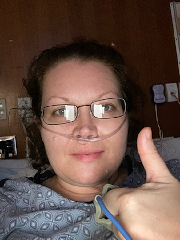 Capt. Danielle Sease, a Global Network Systems Branch budget analyst at Hanscom Air Force Base, Mass., gives a thumbs up while hospitalized with COVID-19, March 31. Sease was diagnosed with the novel Coronavirus and double pneumonia after battling symptoms for nearly a week and is now recovering. (Courtesy photo)
