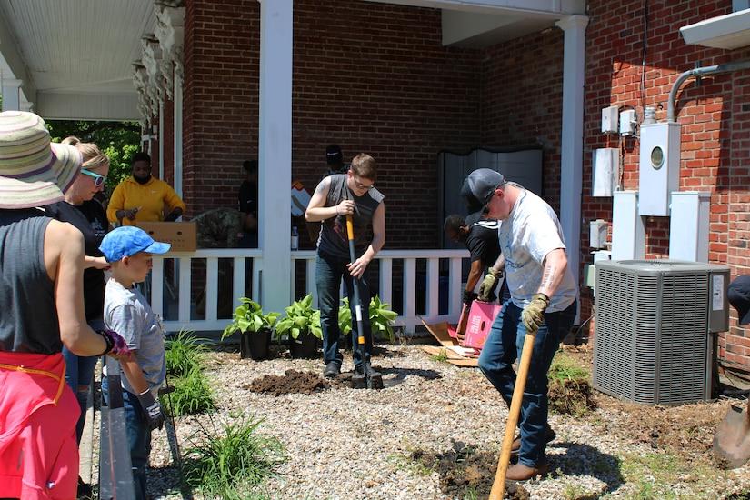 volunteer soldiers plant flowers