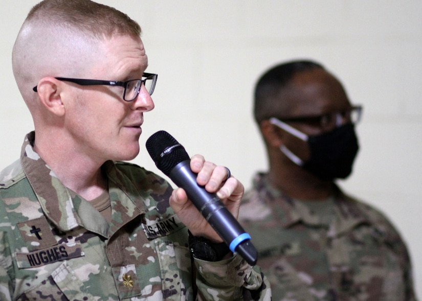 Army Reserve Maj. Eric Hughes, deployed to Camp Arifjan, Kuwait, with the Indianapolis-based 310th Sustainment Command (Expeditionary), to serve as the 1st Theater Sustainment Command's operational command post family life chaplain, speaks at an April 14, 2021 training for the camp's chaplains and enlisted religious affairs specialists. Hughes said he heard the call to ministry during his 2005-2006 deployment to Bagram, Afghanistan, as a Kansas Air National Guard staff sergeant and munitions technician assigned to A-10 Thunderbolts and AC-130s.
