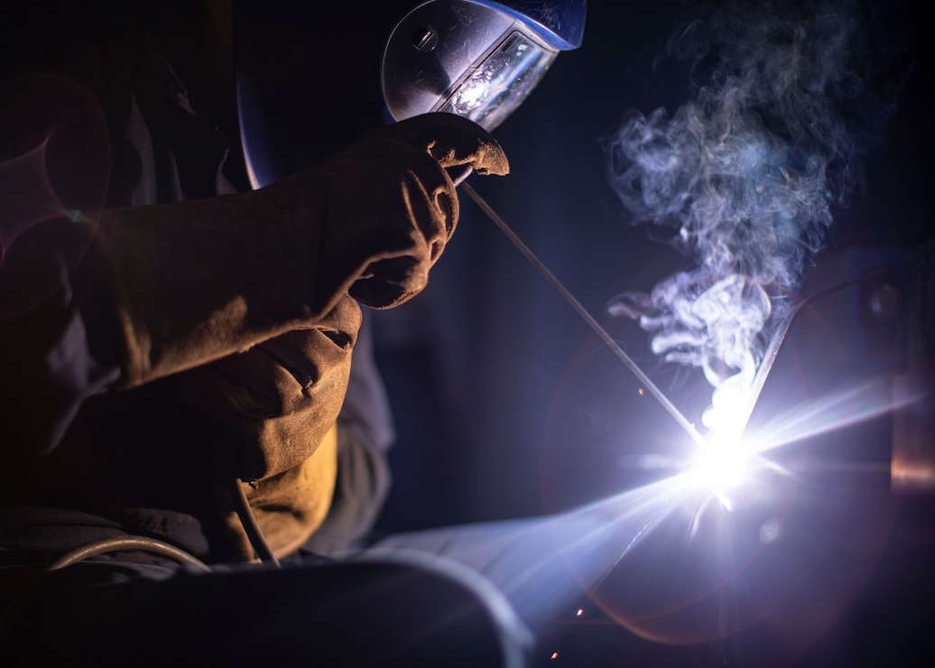 A U.S. Navy sailor welds oxygen tank brackets for the Portland medical clinic, April 26.