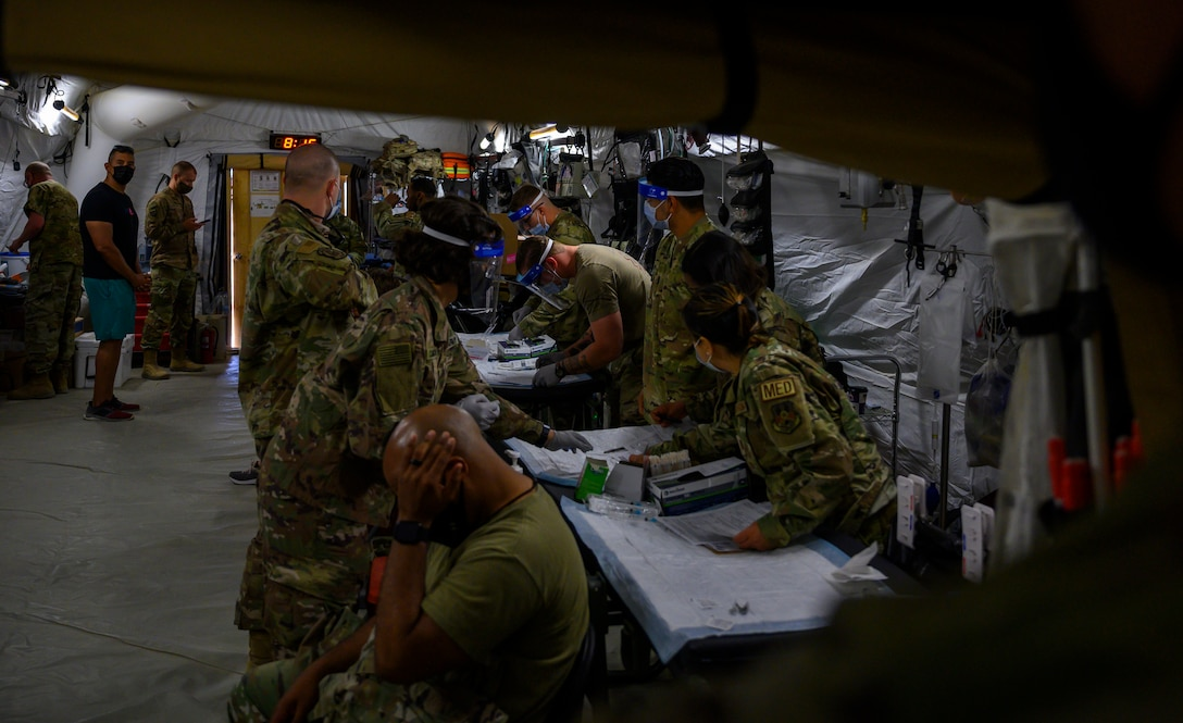 Medical personnel from the 378th Expeditionary Medical Squadron hosted a COVID-19 vaccine distribution event for joint forces at Prince Sultan Air Base, Kingdom of Saudi Arabia, May 4, 2021. The event was part of ongoing efforts to distribute more than 900 Janssen (Johnson & Johnson) COVID-19 vaccine doses, following the DoD Director of Health Affairs' direction for military treatment facilities to resume administration of the vaccine. DoD personnel are highly encouraged to take the vaccine to protect their health, their families, their community, and lower the public health risks associated with the COVID-19 pandemic. (U.S. Air Force photo by Senior Airman Samuel Earick)