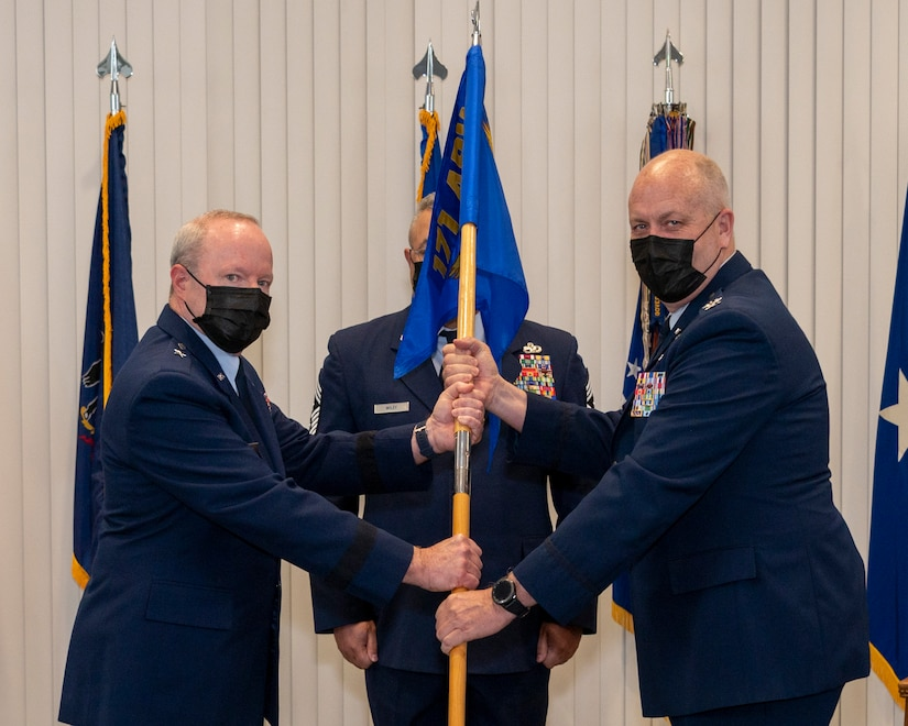 Brig. Gen. Michael J. Regan, left, Commander of the Pennsylvania Air National Guard, presents the 171st Air Refueling Wing guidon to Col. Raymond L. Hyland Jr., incoming 171st ARW commander, during a change of command ceremony May 6, 2021, in Coraopolis, Pennsylvania. Upon taking command, Hyland became the wing's 23rd commander. (U.S. Air National Guard photo by Staff Sgt. Zoe M. Wockenfuss)