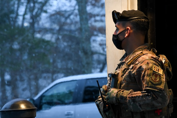 Then-Senior Airman Anthony Arroyo, 66th Security Forces Squadron installation entry controller, stands guard at the Hanscom Air Force Base, Mass., Ruiz Gate Feb. 18. Defenders from the 66 SFS enforce the Controlled Substance Act, a federal law that prohibits the possession or use of marijuana in any form on federal installations by military members, civilians and contractors. (U.S. Air Force photo by Mark Herlihy)