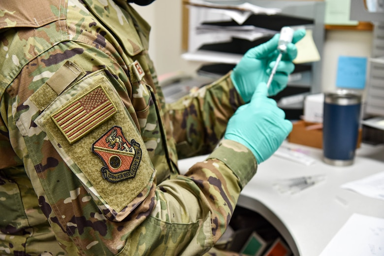 2nd Lt. David Wenger, a clinical nurse with the 134th Medical Group, prepares COVID-19 vaccine shots. Members of the 134th Air Refueling Wing were eligible to receive their COVID-19 vaccines during Unit Training Assembly here May 2nd, 2021.