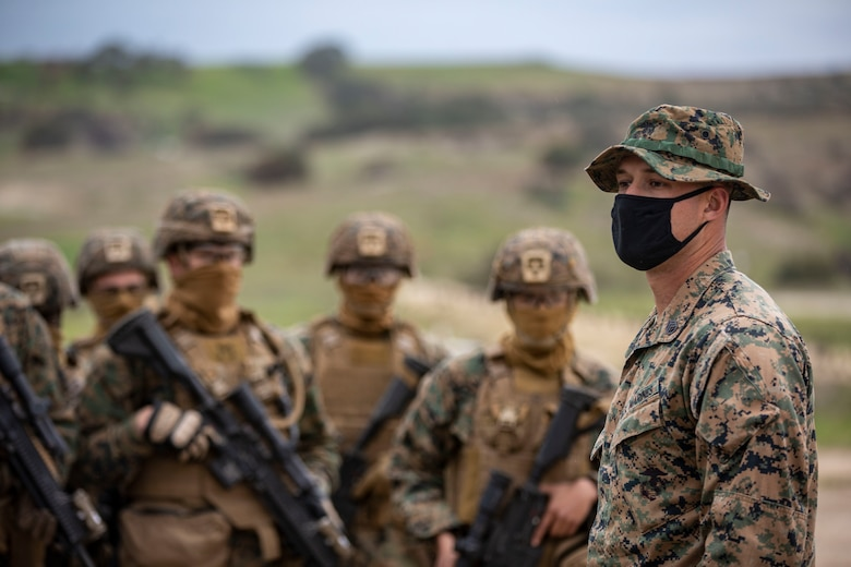 A U.S. Marine gives a safety brief to students before a fire and movement exercise on Range 215A as part of the sixth week of the Infantry Marine Course on Marine Corps Base Camp Pendleton, Calif., March 3.