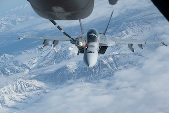 A U.S. Navy F/A-18E Super Hornet refuels from a U.S. Air Force KC-10 Extender over the Joint Pacific Alaska Range Complex.
