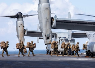 Marines board an MV-22 Osprey aboard USS Makin Island (LHD 8) during Northern Edge 2021.