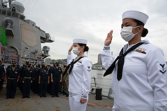 Sailors take the oath of allegiance aboard USS Mustin (DDG 89) to become U.S. citizens.