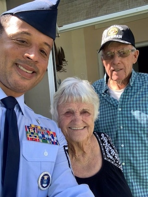 Master Sgt. Carlton Holt, 333rd Recruiting Squadron first sergeant, Patrick Space Force Base, Florida, poses with his neighbors, Francine and Daniel.