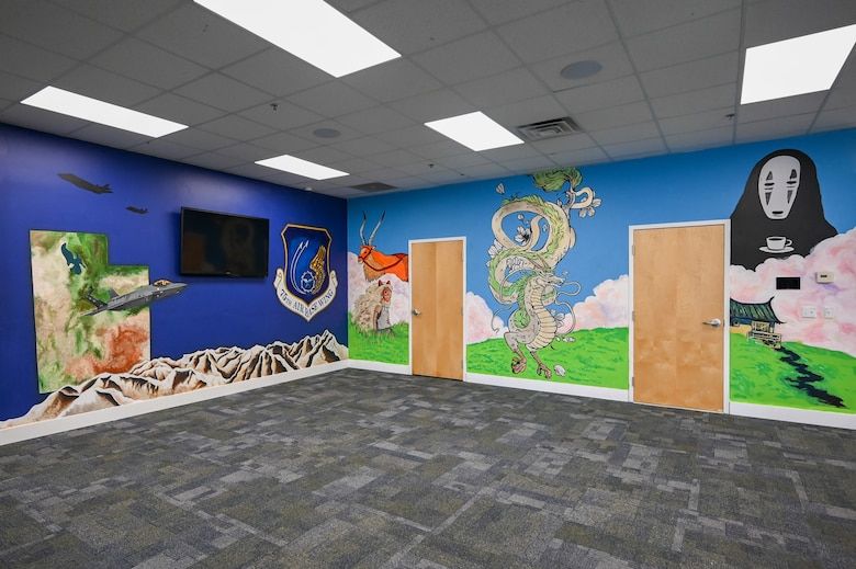 Murals of F-35 fighter jets, the shape of state of Utah, the Wasatch Mountains and mythical creatures on walls inside the Airman Recreation Center.