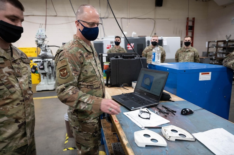 Maj. Gen. Mark Weatherington, the 8th Air Force and Joint-Global Strike Operations Center commander, reviews locally manufactured B-1B Lancer parts during his visit to Ellsworth Air Force Base, S.D., May 4, 2021.