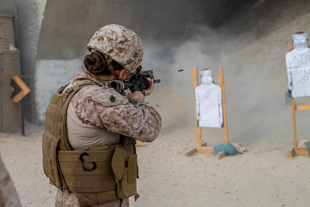 A Marine fires a weapon at a target.