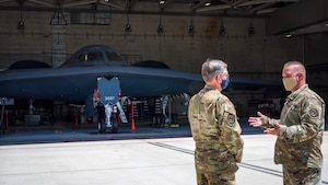 Master Sgt. Brock Schuld, 131st Aircraft Maintenance Squadron, discusses current B-2 weapons upgrades and modernization with Gen. Timothy Ray, Air Force Global Strike Command commander, during his visit to Edwards Air Force Base, California, May 5. (Air Force photo by Giancarlo Casem)
