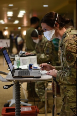 Technicians with the 30th Medical Group process patients receiving their COVID-19 vaccinations during a POD event Jan. 6, 2021, at Vandenberg Air Force Base.