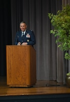 Col. Corey Simmons, 60th Air Mobility Wing commander, speaks at the Specialized Undergraduate Pilot Training Class 21-09 graduation ceremony, May 7, 2021, on Columbus Air Force Base, Miss. As Commander, Simmons is responsible for the combined efforts of all wing operations and support activities associated with the worldwide air mobility mission. (U.S. Air Force photo by Senior Airman Jake Jacobsen)