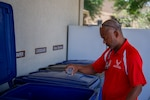 Sarayuth Pinthong, 502nd Air Base Wing Public Affairs visual information chief, does his part by recycling at JBSA-Lackland, Texas, May 5, 2021.
