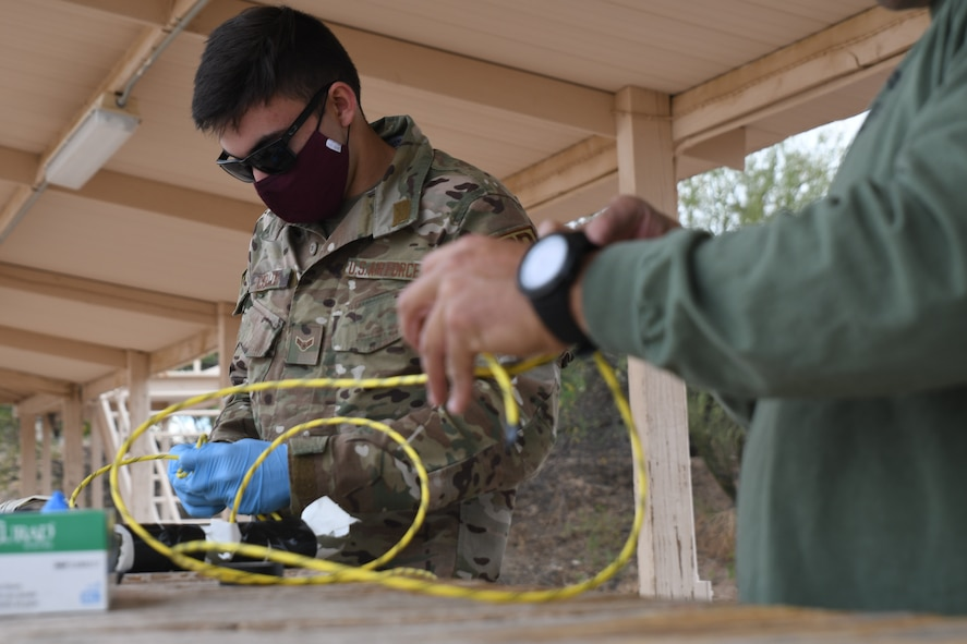 An Airman learning to prepare explosives for demolition training