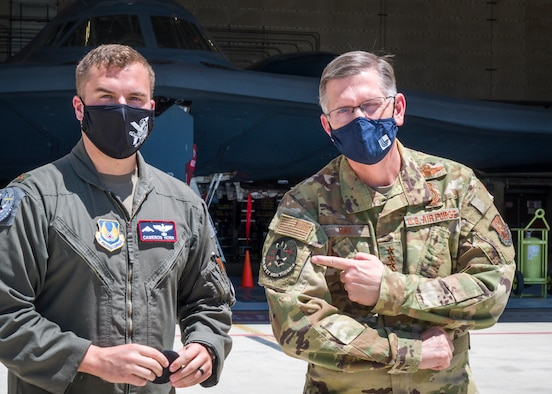Maj. Cameron Horn, 419th Flight Test commander, presents Gen. Timothy Ray, Air Force Global Strike Command commander, with a B-2 test program morale patch during his visit to Edwards Air Force Base, California, May 5. The B-2 fleets continued technological advancement enables expanded strike capabilities while ensuring the aircraft can keep pace with evolving threat levels. (Air Force photo by Giancarlo Casem)