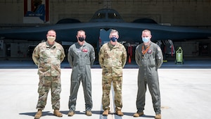 "Gen. Timothy Ray, Air Force Global Strike Command commander, poses for a photo with B-2 test program personnel Master Sgt. Brock Schuld, 131st Aircraft Maintenance Squadron, Lt. Col. Matthew Howard, 110th Bomb Squadron commander, and Lt. Col. Brian Stiles, 72nd Test and Evaluation Squadron commander, in front of the B-2 ""Spirit of Pennsylvania"" during his visit to Edwards Air Force Base, California, May 5. (Air Force photo by Giancarlo Casem)"