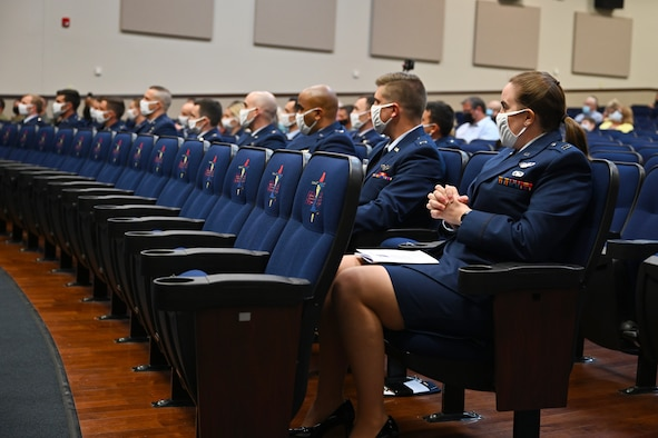 Graduates from Specialized Undergraduate Pilot Training Class 21-09 sit in the Kaye Auditorium during their graduation ceremony, May 7, 2021, on Columbus Air Force Base, Miss. The distinguished graduates of Class 21-09 were 2nd Lt. Samuel Rexroad and 2nd Lt. William Talbott for outstanding performance in academics, officer qualities and flying abilities. (U.S. Air Force photo by Senior Airman Jake Jacobsen)