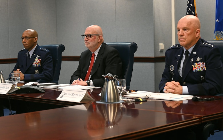 """Acting Secretary of the Air Force John P. Roth (center), Chief of Staff of the Air Force Gen. Charles Q. Brown Jr. (left) and Chief of Space Operations Gen. John W. """"Jay"""" Raymond prepare to answer questions during the House Appropriations Committee on Defense during a virtual hearing at the Pentagon, Arlington, Va., May 7, 2021. Committee members raised topics that included confronting new and emerging threats, air and space superiority, and nuclear deterrence."""