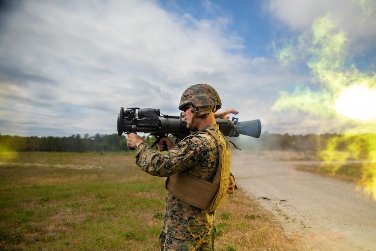 A Marine fires a shoulder held weapon system