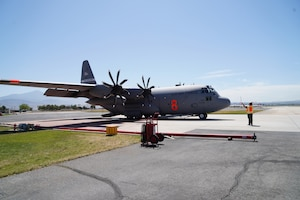 C130-E Hercules aircraft from the 152nd Airlift Wing during MAFFS (Modular Airborne Fire Fighting System) training at the San Bernardino Air Tanker Base, California. May 5, 2021.
