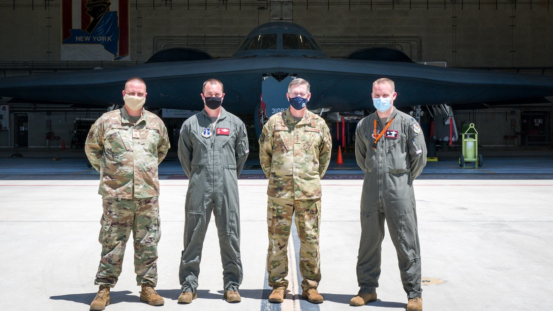 """Gen. Timothy Ray, Air Force Global Strike Command commander, poses for a photo with B-2 test program personnel Master Sgt. Brock Schuld, 131st Aircraft Maintenance Squadron, Lt. Col. Matthew Howard, 110th Bomb Squadron commander, and Lt. Col. Brian Stiles, 72nd Test and Evaluation Squadron commander, in front of the B-2 """"Spirit of Pennsylvania"""" during his visit to Edwards Air Force Base, California, May 5. (Air Force photo by Giancarlo Casem)"""