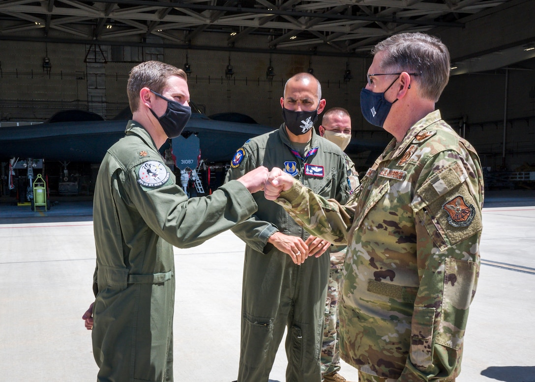 Maj. Matthew Gray, 419th Flight Test Squadron, greets Gen. Timothy Ray, Air Force Global Strike Command commander, during his visit to Edwards Air Force Base, California, May 5. (Air Force photo by Giancarlo Casem)