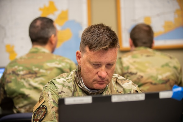 U.S. Air Force Senior Master Sgt. Brian Mohr, the cyber noncommissioned officer in charge for the 175th Cyber Operations Group, Maryland Air National Guard, works on a computer April 21, 2021, at the Gulfport Combat Readiness Training Center, Gulfport, Mississippi.