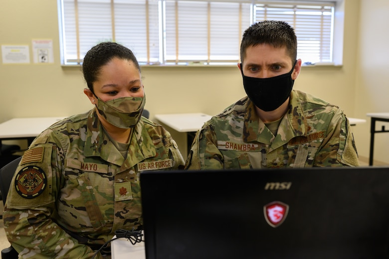 (From left) U.S. Air Force Maj. Christina Mayo, cyber operator for the 175th Cyberspace Operations Squadron, Maryland Air National Guard, and U.S. Air Force Capt. Stephen Shambra, cyber warfare officer for the 275 Cyberspace Operations Squadron, work on a computer April 22, 2021, at the Gulfport Combat Readiness Training Center, Gulfport, Mississippi.