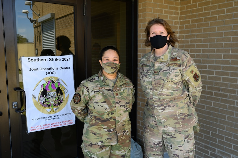(From left) U.S. Air Force Maj. Christina Mayo, cyber operator for the 175th Cyberspace Operations Squadron, Maryland Air National Guard, pose for a photo with U.S. Air Force Col. Cindy Smith, the exercise director of Southern Strike 21, on April 22, 2021, at the Gulfport Combat Readiness Training Center, Gulfport, Mississippi