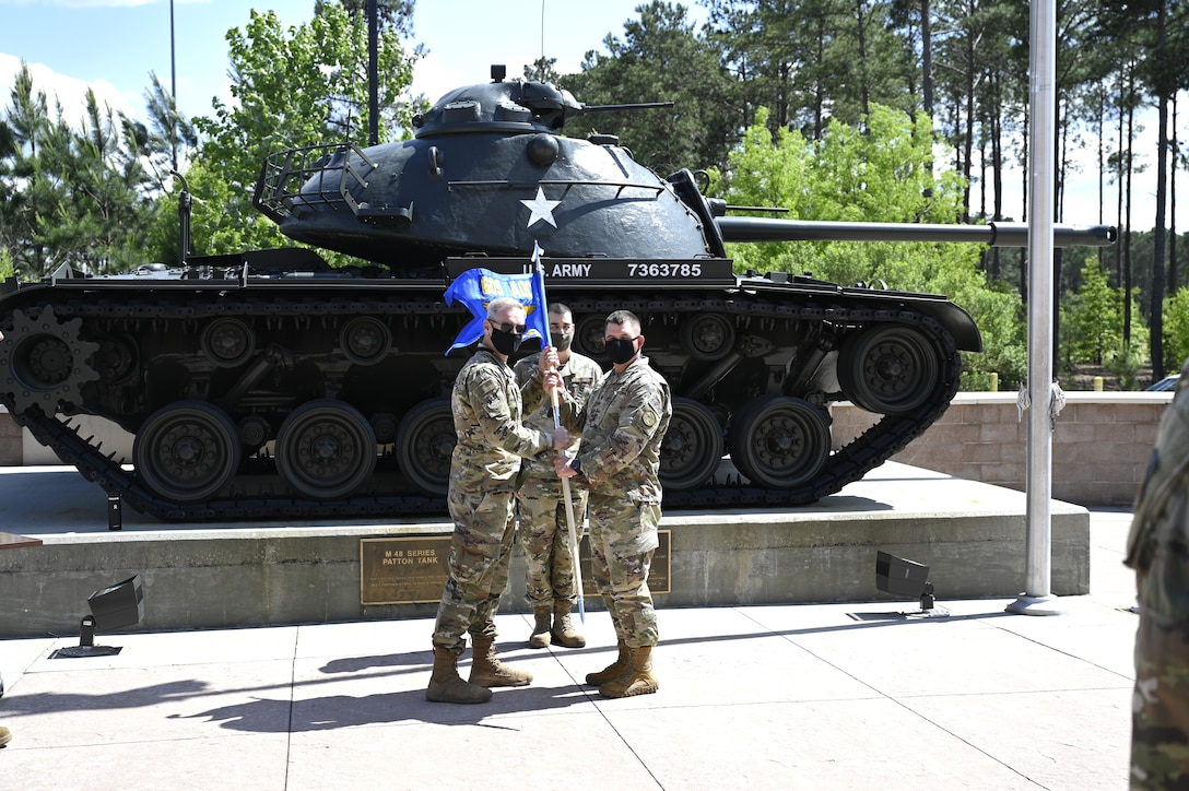 Col. Fredrick A. Coleman III, left, the 609th Air Operations Center commander, poses with Lt. Col. Virnon Garrison, the 727th Expeditionary Air Control Squadron commander, during a realignment ceremony at Shaw Air Force Base, South Carolina, May 7, 2021. The ceremony was held to unveil the new squadron flag for the 727th EACS, representing their realignment from the 380th Expeditionary Operations Group to the 609th AOC. This move enhances 9th Air Force (Air Forces Central)'s operational resilience and demonstrates advancements in the Air Force's ability to distribute operations globally. It also provides a unique opportunity to synchronize command and control functions from the tactical to the operational level. (U.S. Air Force photo by Tech. Sgt. E'lysia Wray)