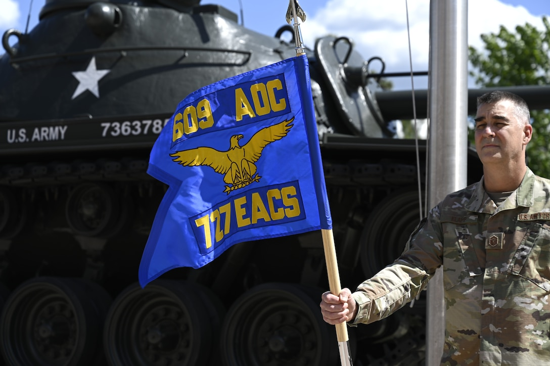The newly unveiled 727th Expeditionary Air Control Squadron's flag waves in the wind during a realignment ceremony at Shaw Air Force Base, South Carolina, May 7, 2021. The ceremony was held to unveil the new squadron flag for the 727th EACS, representing their realignment from the 380th Expeditionary Operations Group to the 609th AOC. This move enhances 9th Air Force (Air Forces Central)'s operational resilience and demonstrates advancements in the Air Force's ability to distribute operations globally. It also provides a unique opportunity to synchronize command and control functions from the tactical to the operational level.  (U.S. Air Force photo by Tech. Sgt E'lysia Wray)