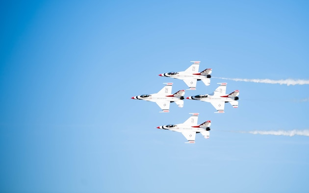 """The United States Air Force Air Demonstration Squadron """"Thunderbirds'' perform an aerial maneuver at the 2021 Barksdale Air Force Base Defenders of Liberty Air Show at Barksdale Air Force Base, Louisiana, May 7, 2021. Barksdale's Air Show showcased performances from the Thunderbirds, F-22 Raptor Demonstration Team and a host of additional acts. (U.S. Air Force photo by Senior Airman Jacob B. Wrightsman)"""