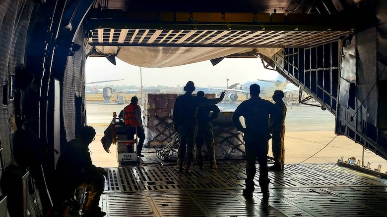 Ground crews offload COVID-19 medical treatment supplies from a 433rd Airlift Wing C-5M Super Galaxy May 5, 2021 at the airport in New Delhi, India. Multiple U.S. Air Force aircraft moved the supplies from Travis Air Force Base, California. (Courtesy photo)