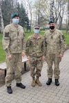 Sgt. Bradley Taylor, center, a medic with the Pennsylvania National Guard's 108th Medical Company Area Support, with two Lithuanian Army Soldiers on a Lithuanian Army base in Marijampole, Lithuania, where Taylor is providing medical support to U.S and Lithuanian troops. The 108th MCAS deployed to Europe in late February to provide medical support to U.S. and allied rotational forces in the region.