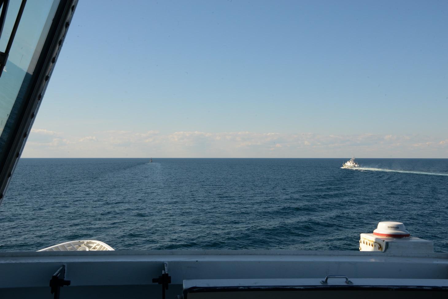 USCGC Hamilton (WMSL 753) and a Ukranian coast guard vessel conduct underway maneuvers in the Black Sea.