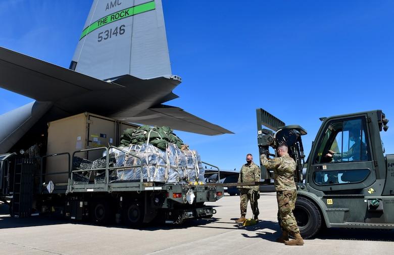 Airmen offload cargo from a C-130J Super Hercules