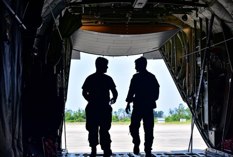 Loadmaster look out of a C-130J Super Hercules