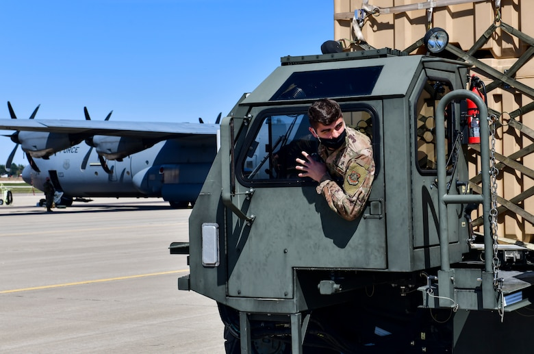 An Airman assigned to the 19th Logistics Readiness Squadron backs up a K-loader after offloading cargo from a C-130J Super Hercules